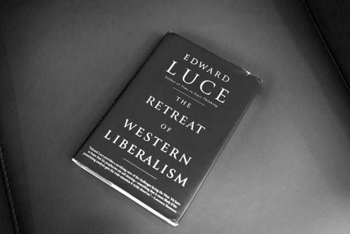 the retreat of western liberalism η υποχώρηση του δυτικού φιλελευθερισμού... Ο Αθανάσιος Παπανδρέου επισείει τον κίνδυνο ο φιλελευθερισμός να καταρρεύσει στις δυτικές κοινωνίες. Και αυτό γιατί όταν μία χώρα με ημι-ολοκληρωτικό καθεστώς ηγείται της απελευθέρωσης της παγκόσμιας αγοράς, κάτι δεν πάει καλά στις φιλελεύθερες δημοκρατίες. new deal